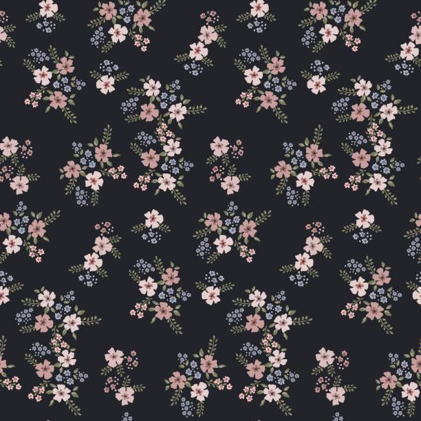 Floral seamless pattern of small flowers in pastel colors on a dark blue background Floral seamless pattern of small flowers in pastel colors on a dark blue background small stock illustrations