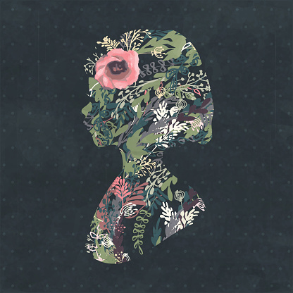 Floral silhouette portrait of a beautiful girl in profile