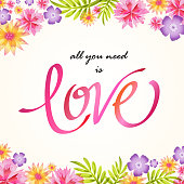 Love calligraphy in a spring bloom background.