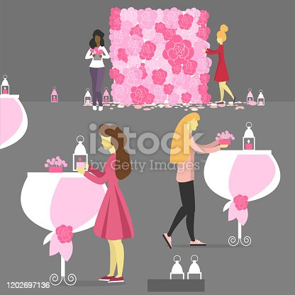 istock Florists  decorate the interior for the wedding at work. 1202697136