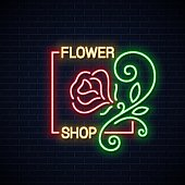 Flower shop neon sign. Flowers store neon banner on wall background 10 eps