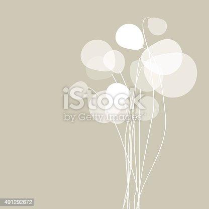 Flowers dandelions on a beige background.