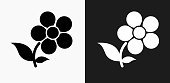 Flowers Icon on Black and White Vector Backgrounds. This vector illustration includes two variations of the icon one in black on a light background on the left and another version in white on a dark background positioned on the right. The vector icon is simple yet elegant and can be used in a variety of ways including website or mobile application icon. This royalty free image is 100% vector based and all design elements can be scaled to any size.