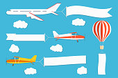 Flying advertising banner. Planes and hot air balloon with horizontal and vertical banners on blue sky background