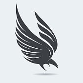 Stylized flying down bird silhouette in grey and black colors. Attacking hunting Eagle image. Vector illustration. Works well as a tattoo, emblem, print or mascot.