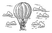 Hand-drawn vector drawing of a Flying Hot Air Balloon. Black-and-White sketch on a transparent background (.eps-file). Included files are EPS (v10) and Hi-Res JPG.