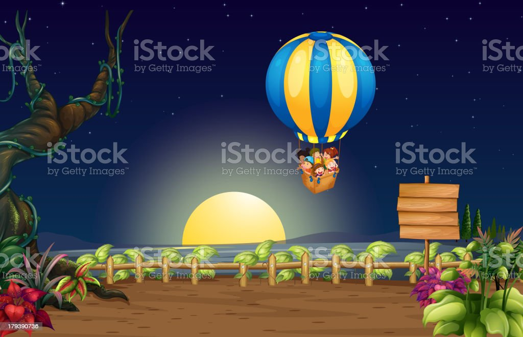 Flying hot air balloon in the middle of night royalty-free stock vector art