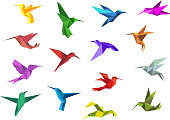 Flying origami hummingbirds or colibri birds