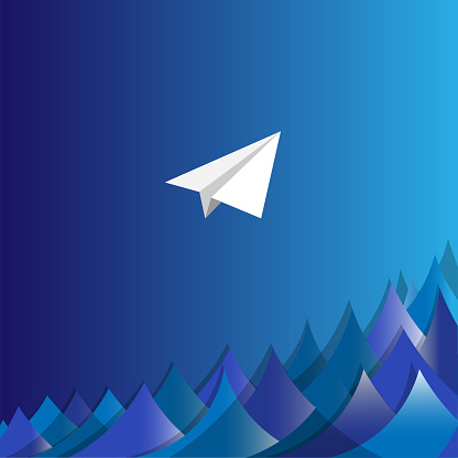 A paper plane flies through the night over the sea.