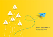 istock Flying paper airplanes. Think differently, leadership, trends, creative solution and unique way concept. Be different. 1254253711