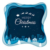 Flying Santa on night sky in city town scenery in the winter with homes and snowy hills. Winter holiday design paper art and crafts. Christmas greeting card illustration. Vector