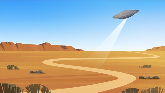 Flying saucer over the desert landscape. UFO over Nevada.