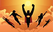 A silhouette style illustration of a superhero team flying in formation above the clouds, ready to save the world. Copy space available, perfect for website header and FB cover.
