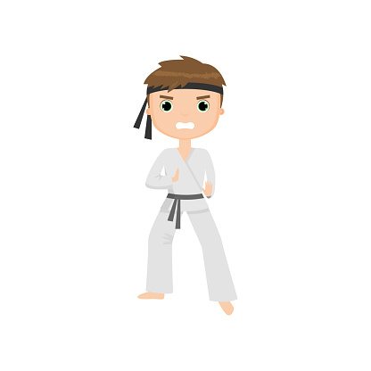Focused and angry cute little boy doing karate isolated on white background