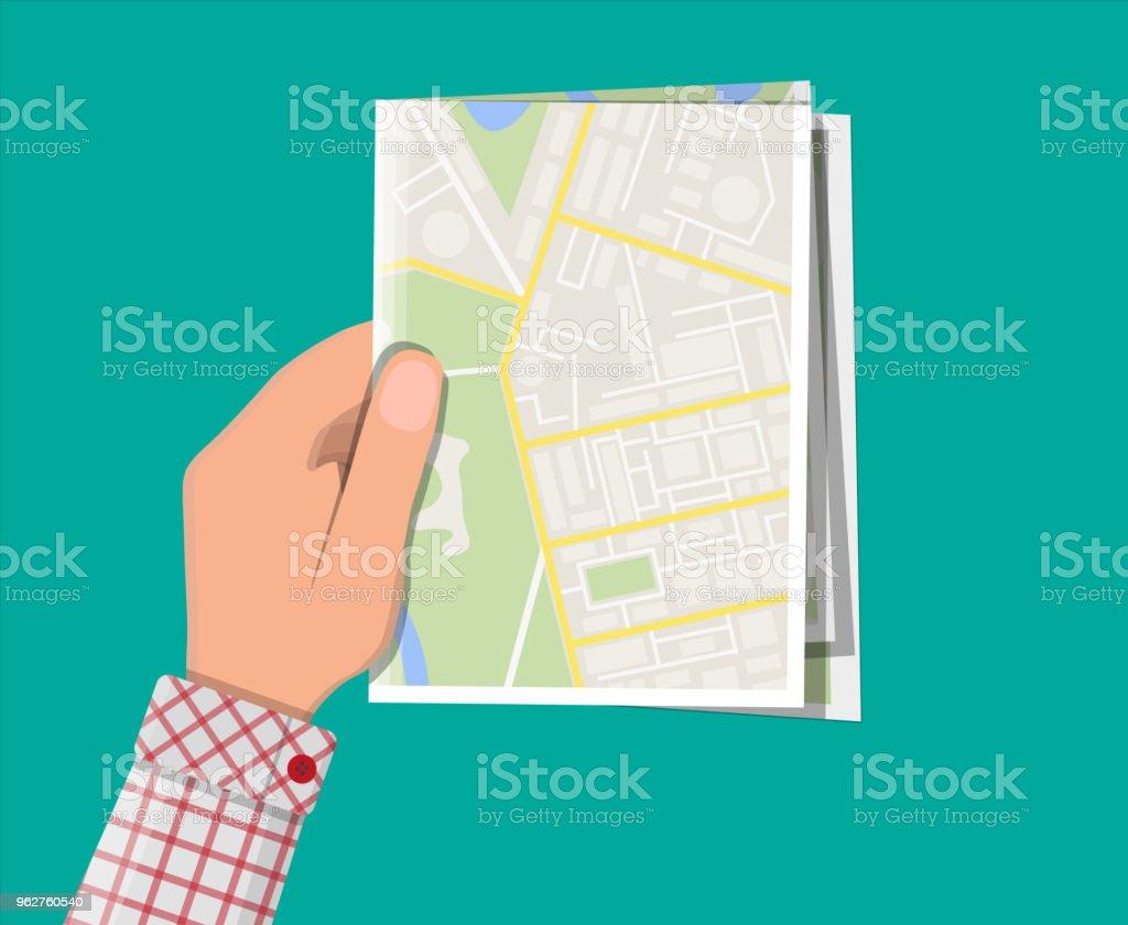 Dobrado o mapa da cidade de papel na mão - Vetor de Aldeia royalty-free