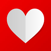 Folded white paper heart Icon with shadow on red background. Minimal flat red love symbol.