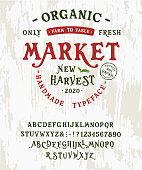 Font Organic Market. Hand crafted typeface design. Handmade alphabet type on a wooden board. Textured background. Doodle vector letters and numbers. Ecology template logo, label, badge, element.