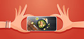 food blogger taking mobile photo of fresh vegetable salad with chicken and sauce top angle view smartphone screen social network activity concept horizontal