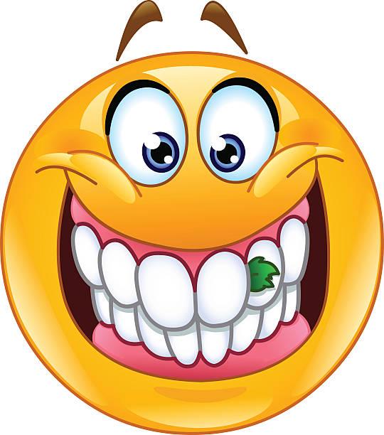 food stuck in teeth emoticon - feststecken stock-grafiken, -clipart, -cartoons und -symbole