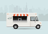 Food truck with city landscape. Flat styled vector illustration.