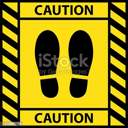 istock Foot position warning sign sticker reminding of keeping distance to protect from Coronavirus or COVID-19, Vector illustration of feet step keep a safe social distancing 1215962756