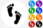 Foot Prints.The icon is black and is placed on a round blue vector button. The button is flat white color and the background is light. The composition is simple and elegant. The vector icon is the most prominent part if this illustration. There are eight alternate button variations on the right side of the image. The alternate colors are orange, red, purple, yellow, black, green, blue and indigo.