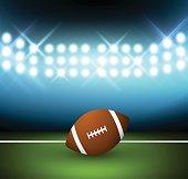 Football ball on a field