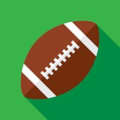 Vector illustration of a football against a green background in flat style.