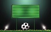 football on grass and scoreboard