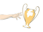 Football / Soccer flying cup in the line art style. Hand reaching for bowl.