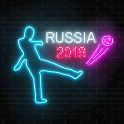 Football world cup 2018 in Russia neon glowing signboard on a dark brick wall background.