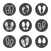 Footprint icons set vector illustration. Barefoot prints and boots footrints icons