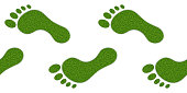Human footprints with grass texture, seamless horizontal pattern. On a white background, isolated. Vector illustration.