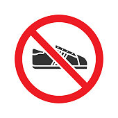 Forbidden sign with sneaker glyph icon. Vector silhouette. Shoes prohibition