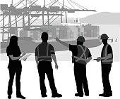 Foreman Instructing The Workers At The Port