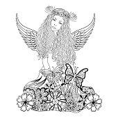 Forest fairy with wings and wreath on the head
