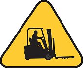 Vector illustration of a forklift silhouette of a gold triangle with black border.