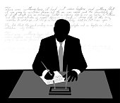 Silhouette of a business man handwriting in cursive