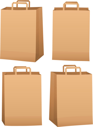 Four brown grocery bags with small handles