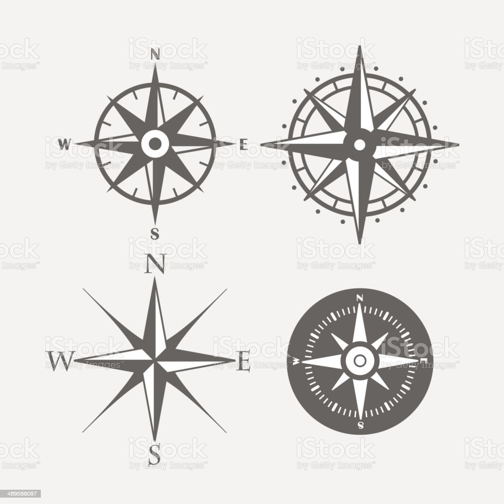 Four directional compasses with different styles vector art illustration