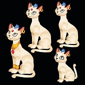 Four Egyptian figurines of white cats