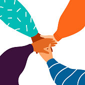 Four female hands support each other, concept of teamwork, women power. Diverse human hands united for social freedom and peace.