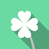 Four leaf clover or shamrock on green background with a long shadow vector illustration