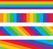 Vector silhouette of four different rainbow striped banners.