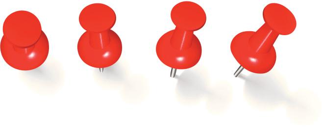 Four red thumbtacks stuck on white background