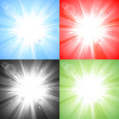Four sun bursts on different colored backgrounds