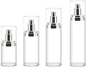 Four transparent cosmetic bottles
