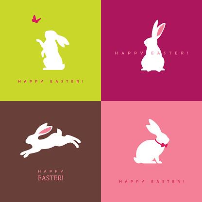 Four white bunny silhouettes