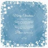 Frame from a variety of snowflakes on a chalkboard. Christmas blue background