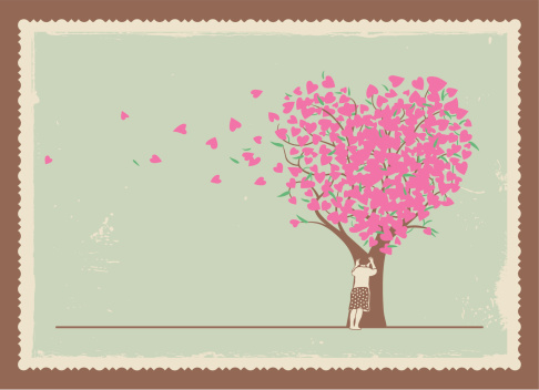 Frame of girl leaning on a tree with heart shaped leaves